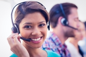 stock-photo-close-up-plan-of-a-smiling-businesswoman-in-a-call-centre-295924556